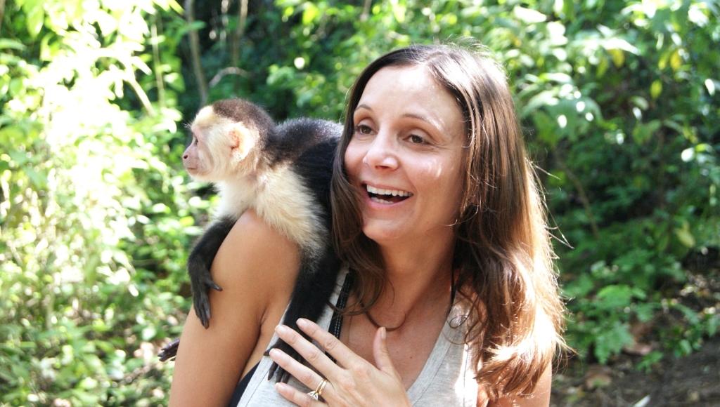 Annette White Holding a Monkey in Honduraa