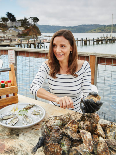Annette White in Point Reyes shucking an oyster