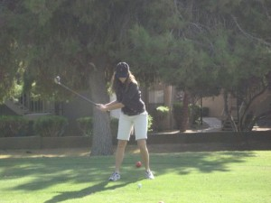 Annette White playing golf game