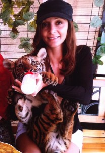 Annette White feeding a tiger