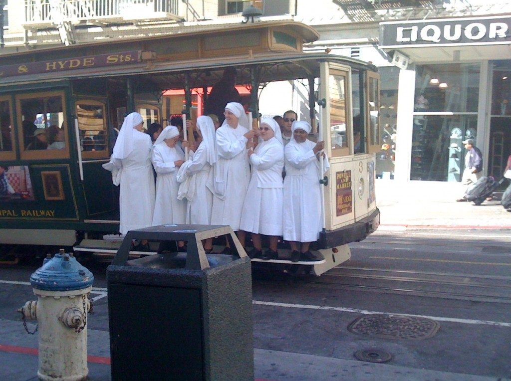 Nuns riding a cable car in San Francisco