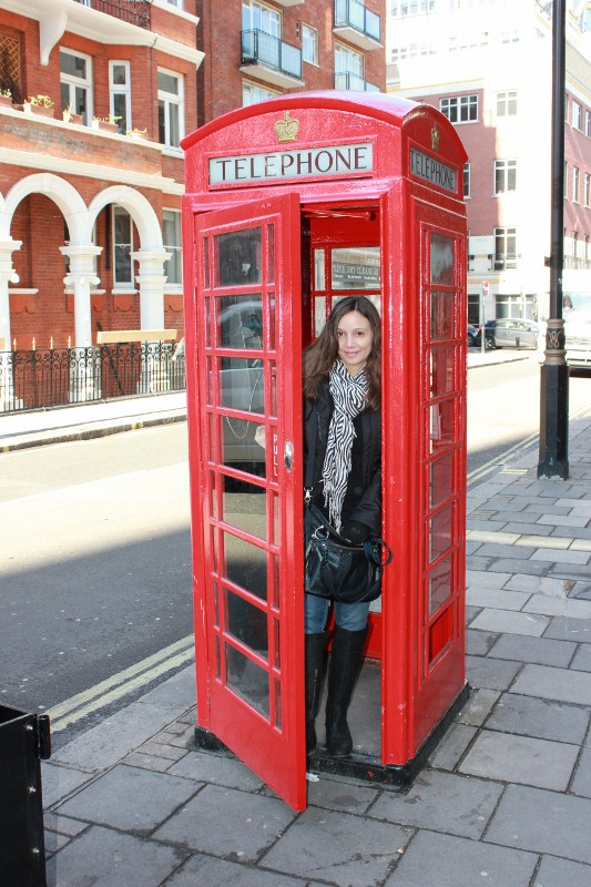 Annette White in Red Phone Booth in London