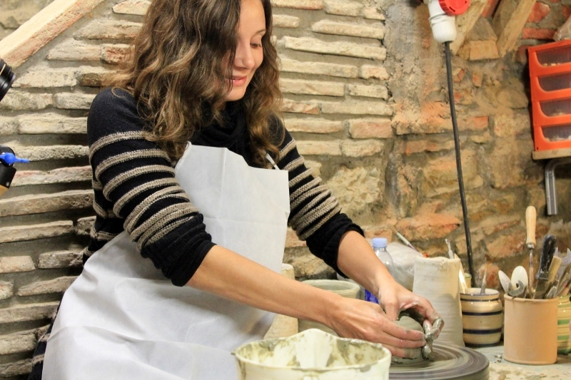 Annette White making pottery in Tuscany