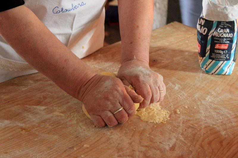 Kneading Dough in Pasta Making Class in Italy