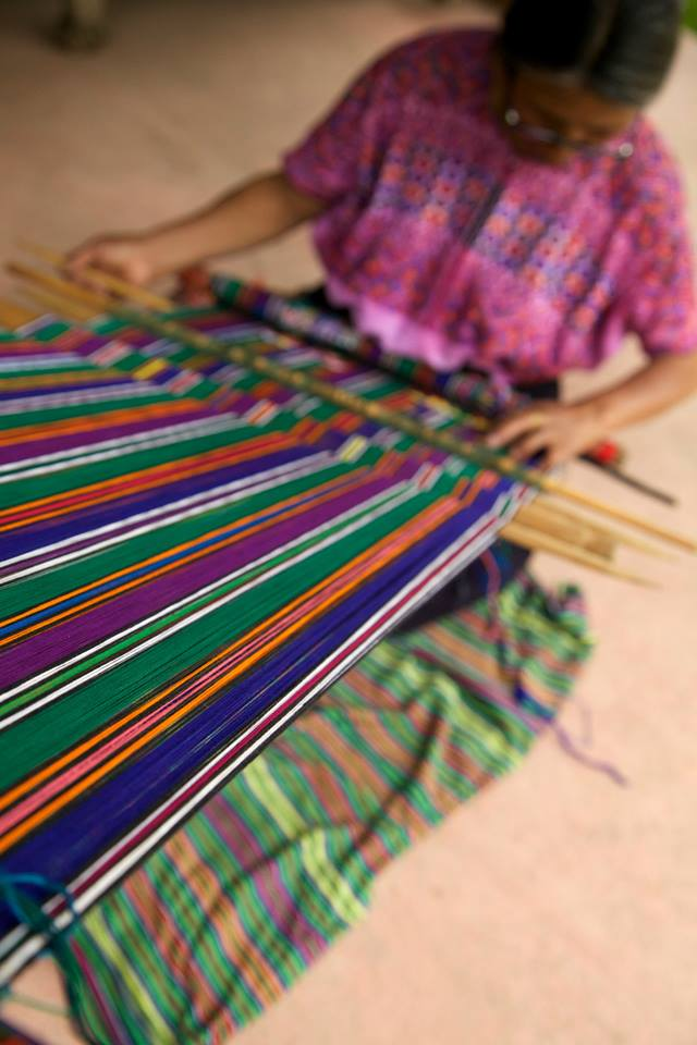 lady-working-loom