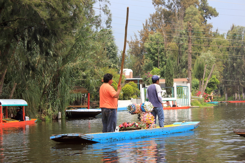 Vendors on a Trajinera Gondolas in Xochimilco
