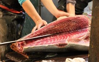 Butchering ahi at Tsukiji Fish Market in Tokyo