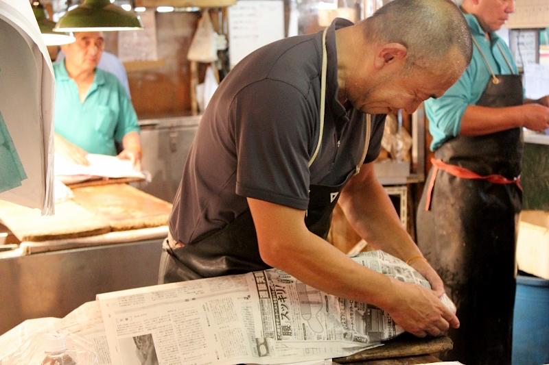 Wrapping ahi at Tsukiji Fish Market in Tokyo