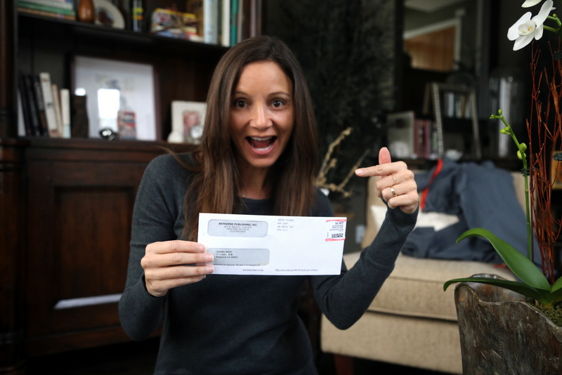 Annette White with her Book Advance Check