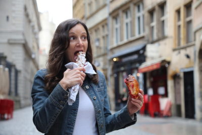 Annette White Eating French pastries in Lyon