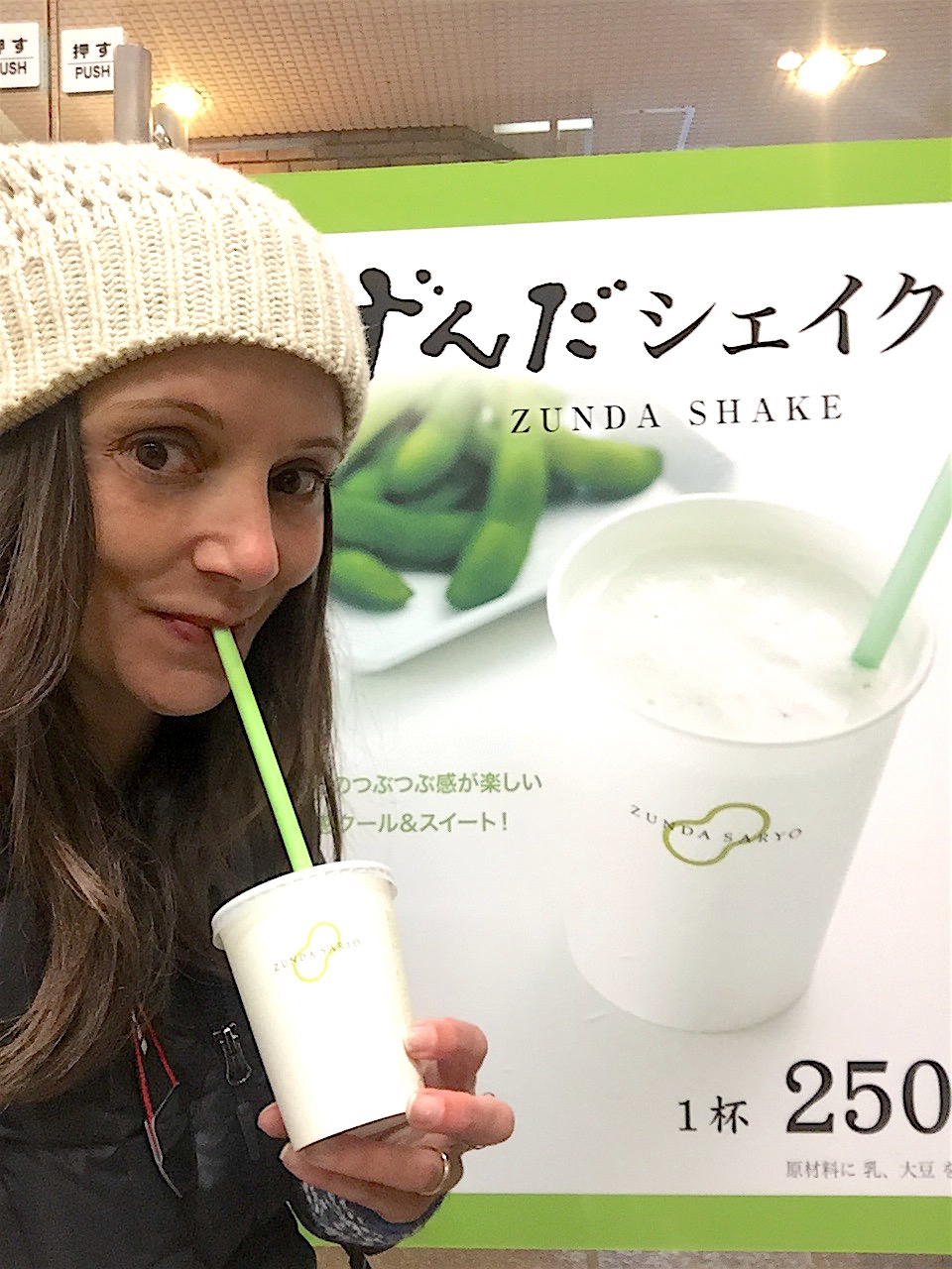 Annette White drinking a traditional Zunda Shake in Sendai, Japan