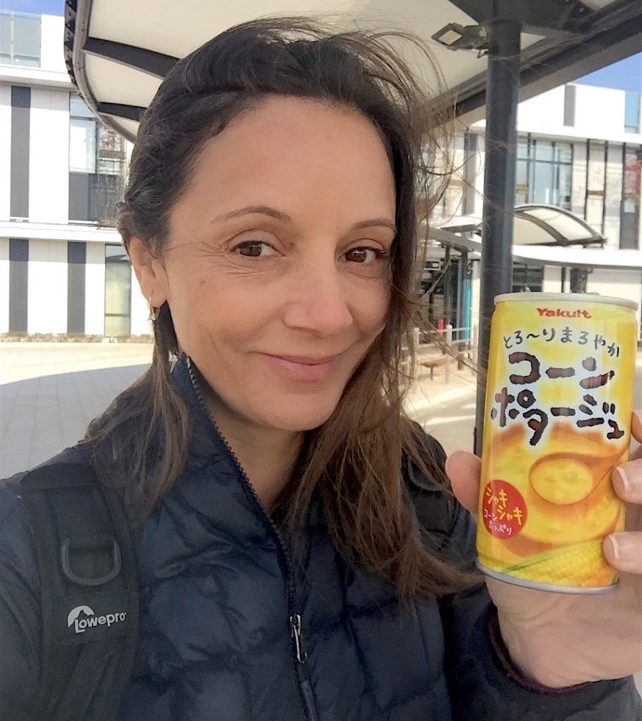 Annette White eating from a vending machine in Japan