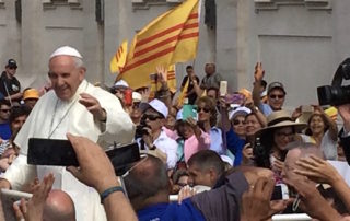 Pope Francis in the popemobile at the Vatican in Rome