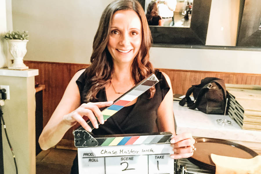Annette White with a Clapperboard