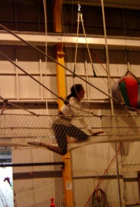 Annette White attempting to trapeze