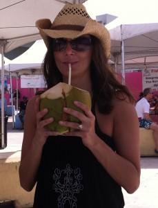 Annette White drinking fresh coconut juice