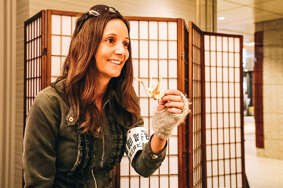 Annette White making an origami crane in Japan