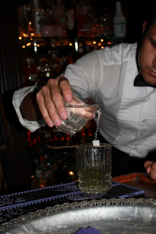 Making absinthe at speakeasy