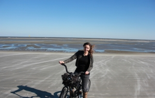Annette White on her Bike on the Beach