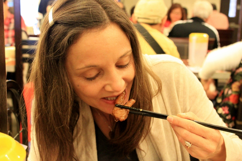 Annette White Eating Chicken Feet in Hong Kong