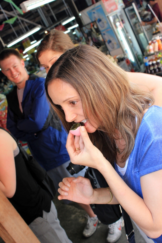Annette White Eating a Century Egg in Chiang Mai Thailand