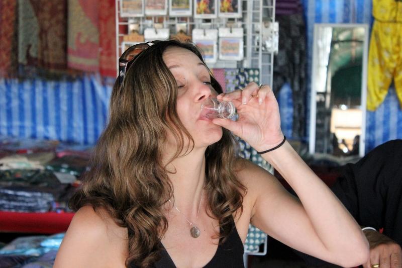 Annette White drinking Snake Whiskey in Laos