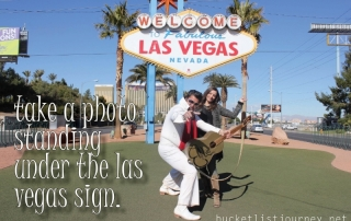 Photo Standing Under the Las Vegas Sign