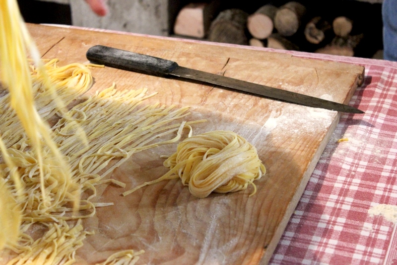 Tagliatelle Pasta Haystack on Wooden Cutting Board