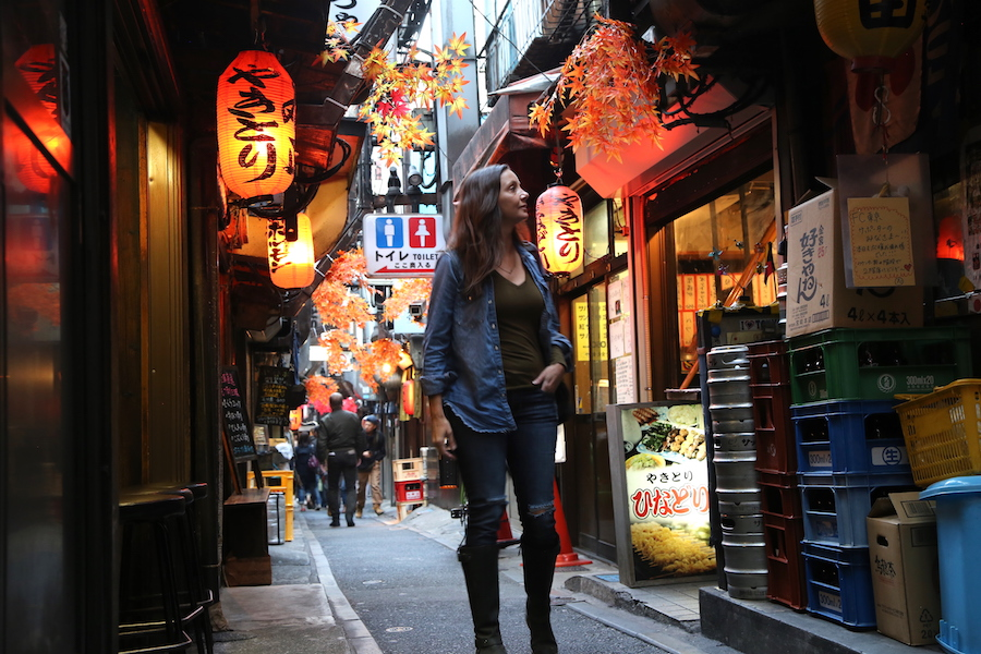 Best Tokyo Bucket List: 44 Top Things To Do, Places to Visit and Attractions in Japan's Coolest City: Annette White walking through Tokyo's Piss Alley