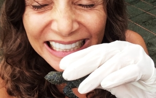 Annette White in Costa Rica with Baby Turtles