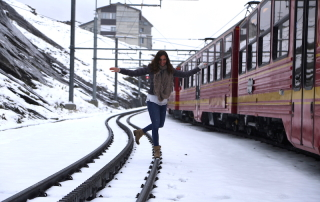 Annette White playing on the train tracks in Switzerland
