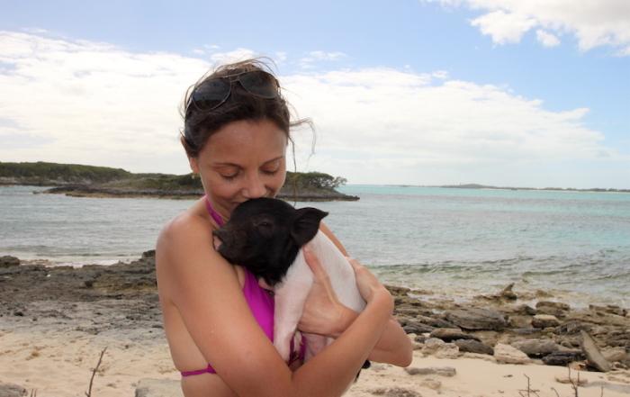 Annette White swimming pigs of Exuma, Bahamas