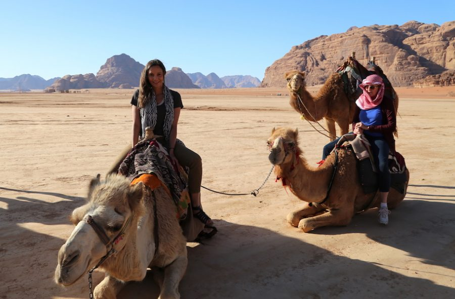 Annette White on a camel in Wadi Rum Jordan