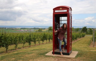 Annette White in the Luckett Vineyard Phone Booth in Nova Scotia