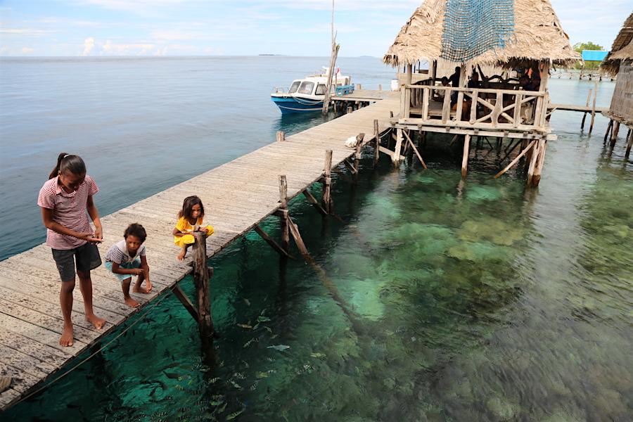 Feeding the Fish at Sawinngrai Village in Indonesia