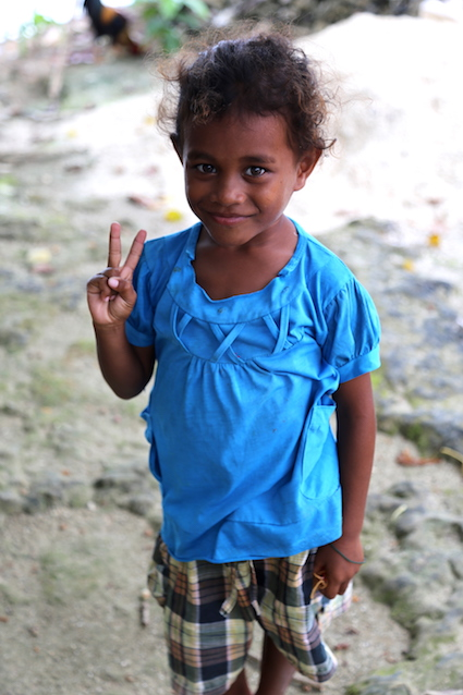 The cute little locals of Sawinggrai Village in Indonesia