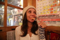 Annette White eating fresh fish at Tsuda-Sengyoten isakaya in Sendai Japan