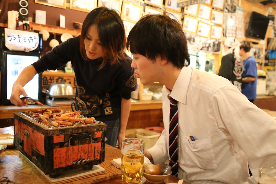 Cooking on the table top barbecue at Tsuda-Sengyoten isakaya in Sendai