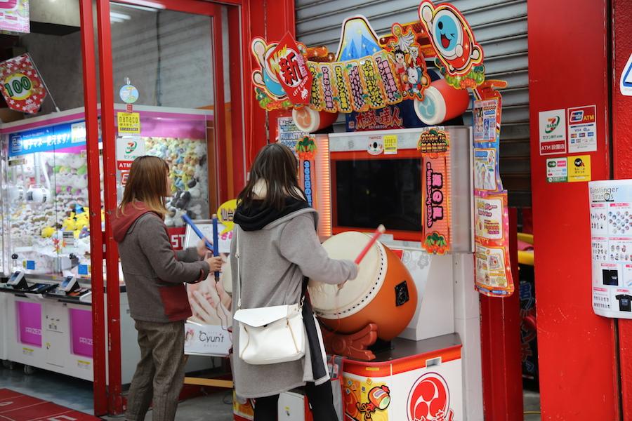 Playing at a game center in Sendai, Japan