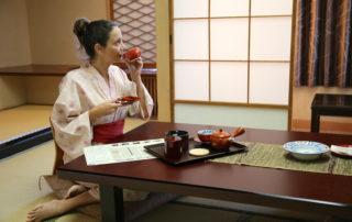 Annette White in a Kimono having tea in a traditional ryokan