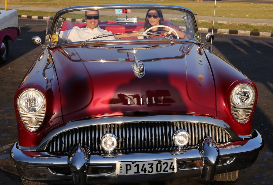 Havana Bucket List: 16 Things to Do & Places to Visit In Cuba's Capital: Annette White riding in a Vintage Convertible