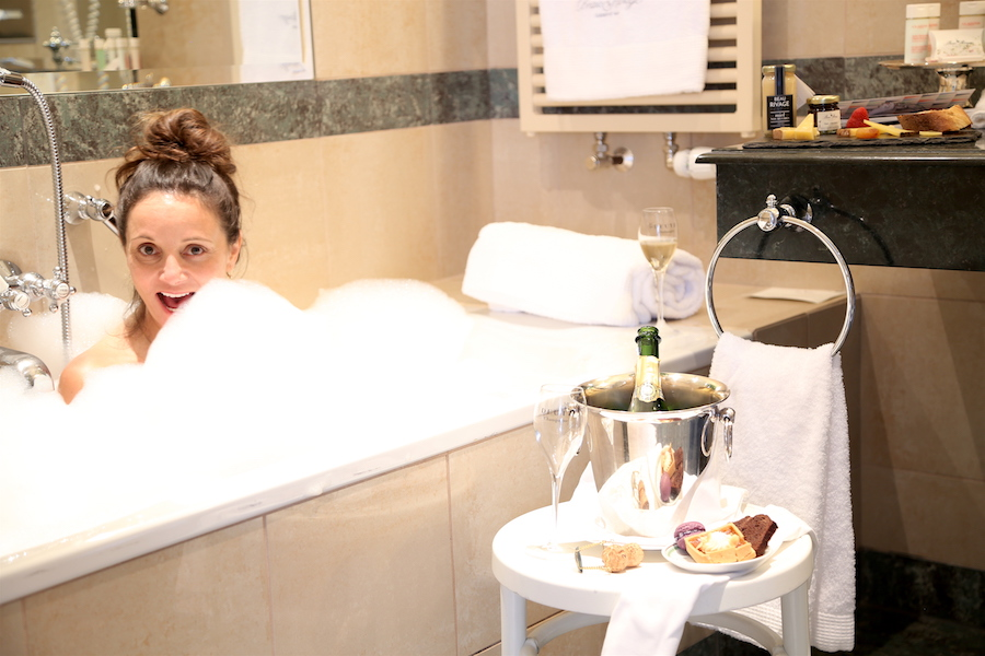 Annette White taking a tub soak at Beau Rivage Hotel in Geneva Switzerland