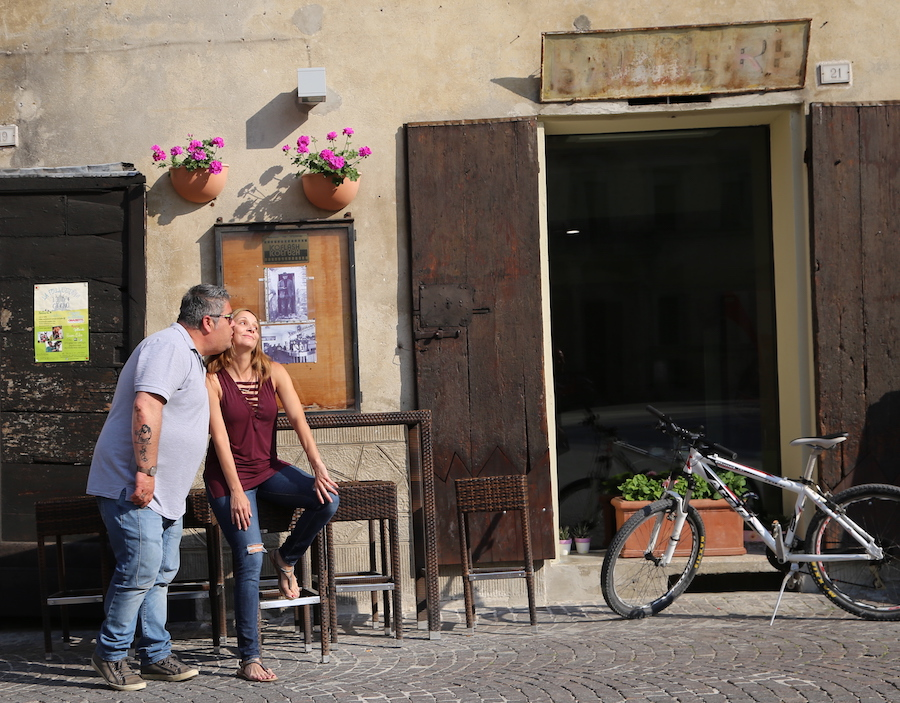 Annette White getting a kiss from a local in Mercatello sul Metauro in Le Marche, Italy