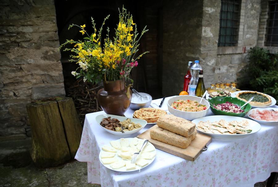 Outdoor dining at Palazzo Donati in Mercatello sul Metauro in Marche, Italy