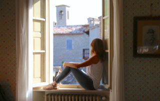 Annette White in the window of Palazzo Donati villa in Mercatello sul Metauro