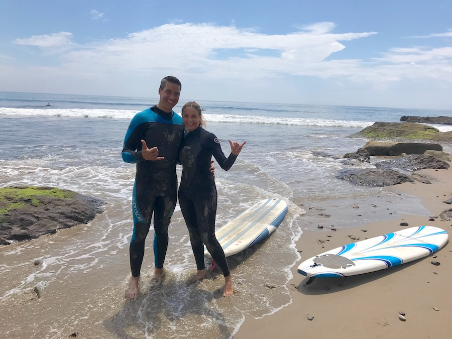 Peter & Annette White surfing in Goleta, California