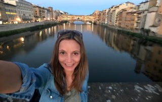 Annette White watching the sun go down on the Arno River in Florence