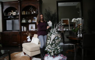 Annette White decorating her Christmas tree