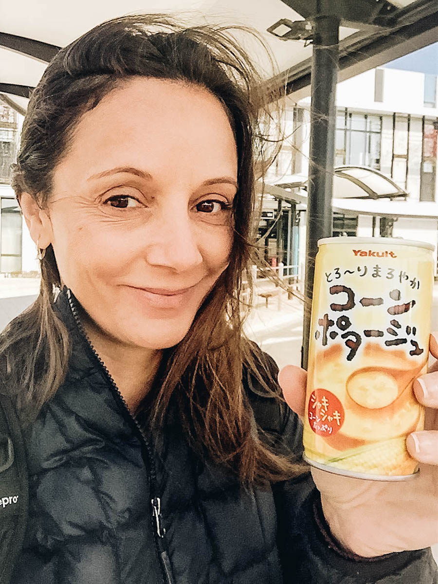 Annette White eating from Vending Machines in Japan