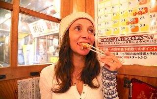 Annette White using chopsticks in Japan